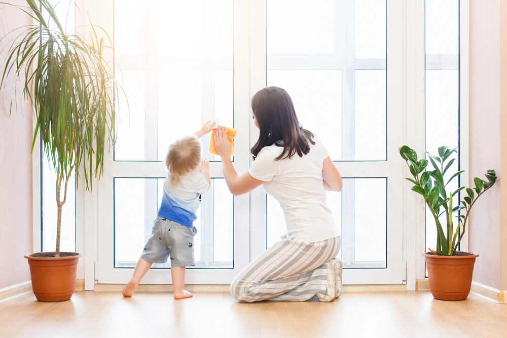 toddler and mother washing windows