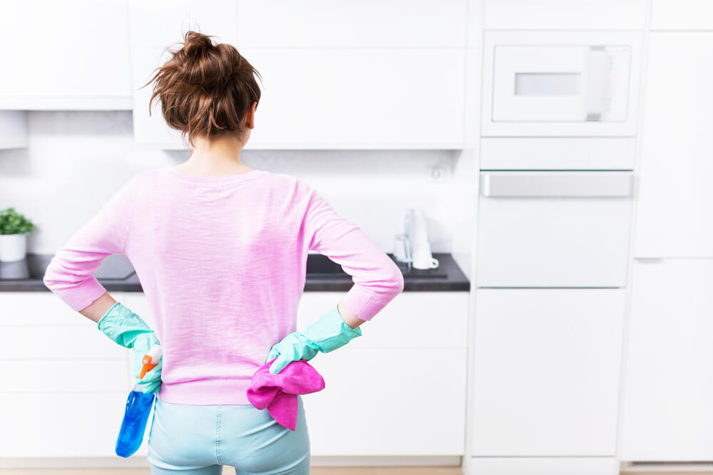 woman proud with clean kitchen