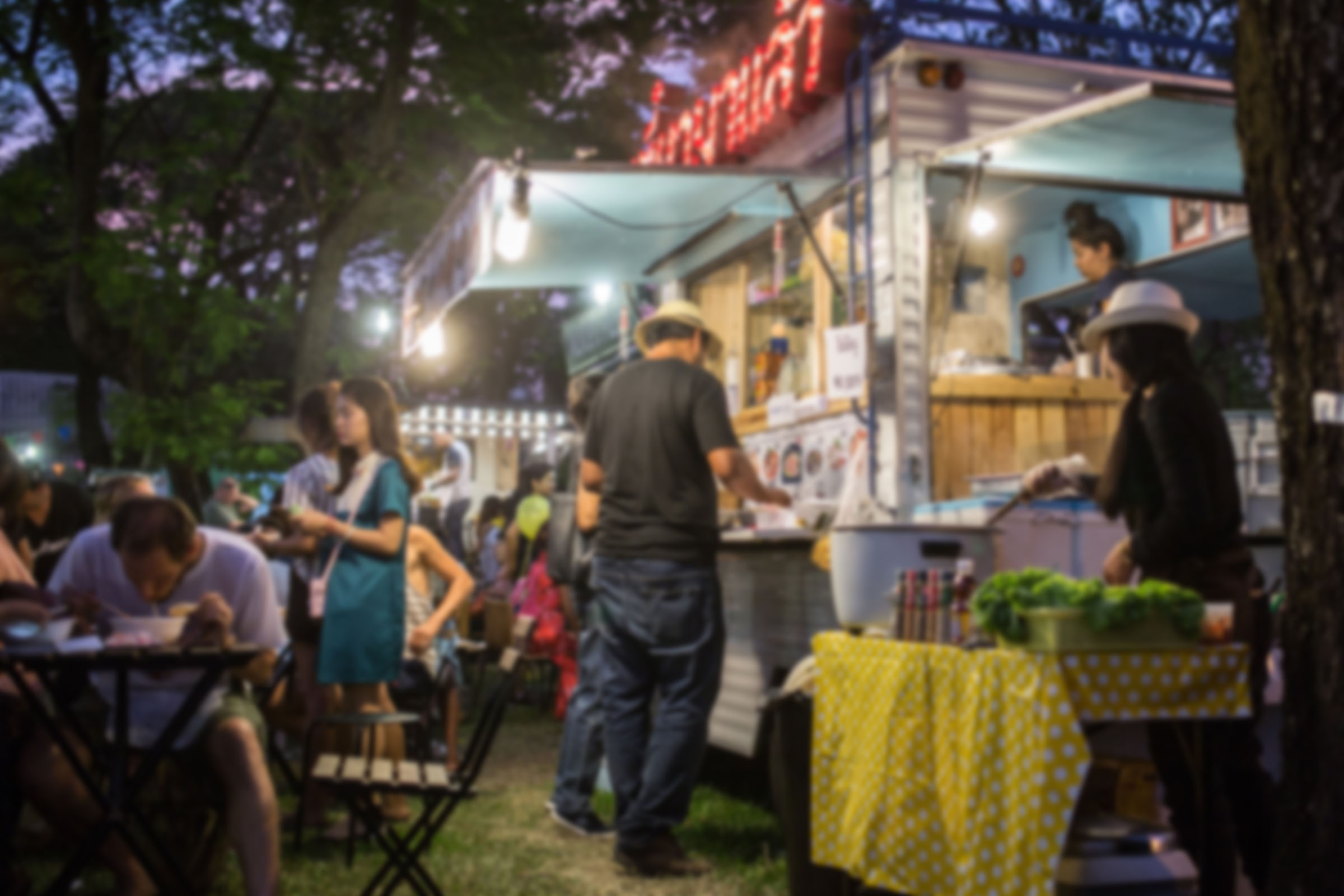 food truck festival with people picking food