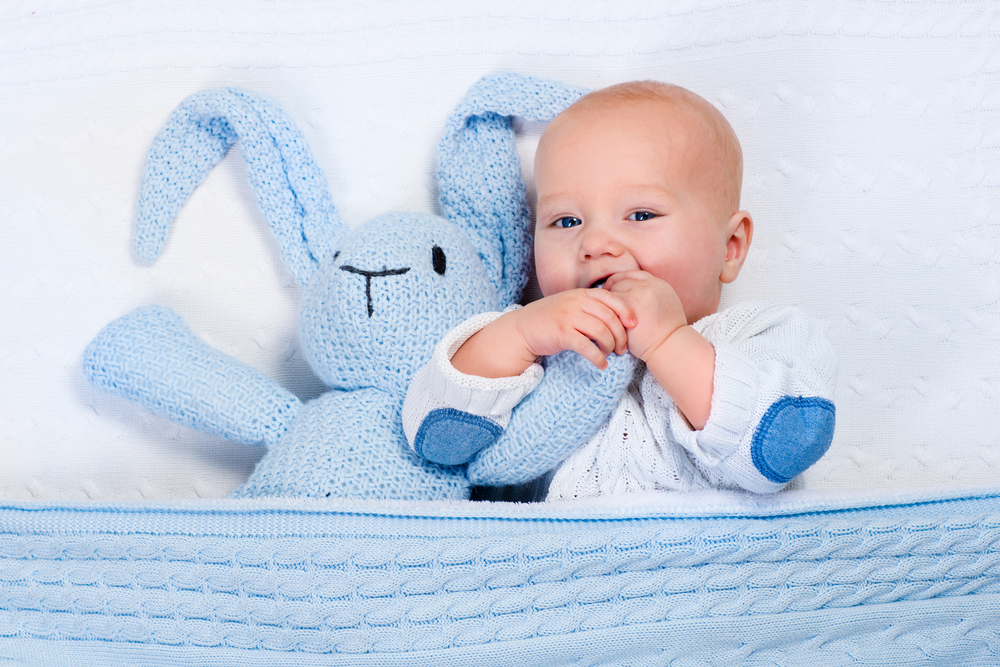 happy baby and bunny doll in small city apartment