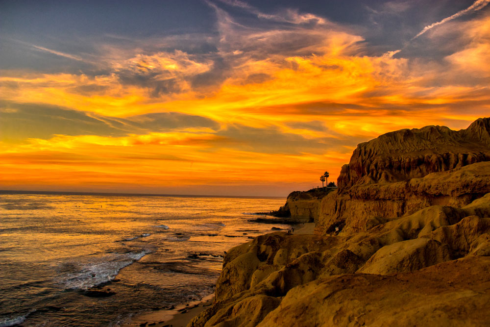 sunset on the cliffs and beach of san diego